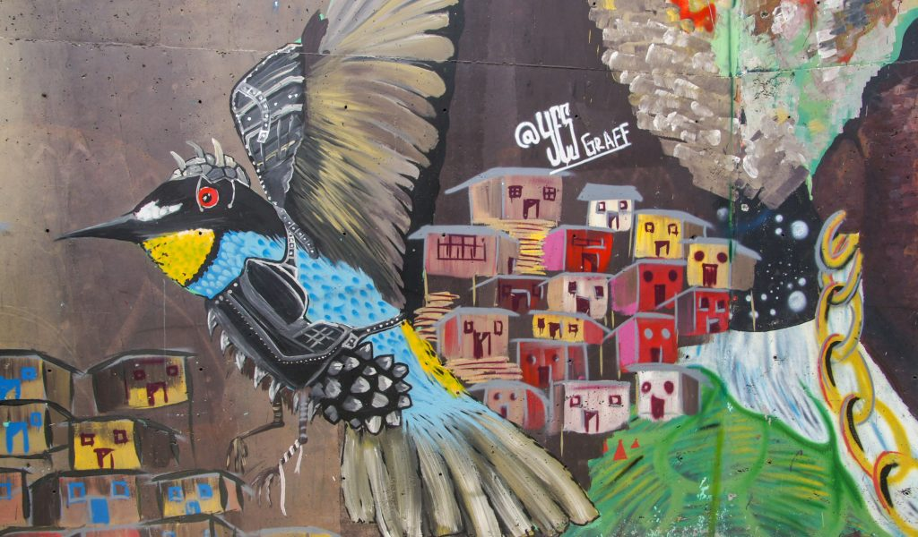 What to see in Comuna 13 most beautiful graffiti of Medellin