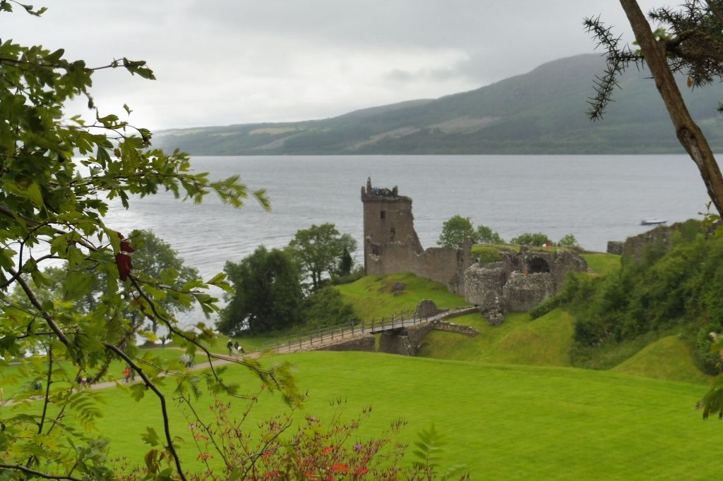 the Loch Ness Lake and its Urqhart Castle ruins